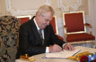 Czech Republic\'s President Milos Zeman signs the European Union bailout fund at the Prague Castle in Prague, Czech Republic, Wednesday, April 3, 2013. (AP Photo/Petr David Josek)