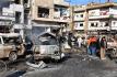 Následky sebevražedných útoků v syrském Homsu, při kterých zahynulo nejméně 22 lidí.