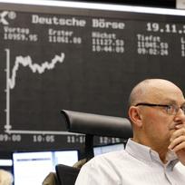 Obchodník na burze ve Frankfurtu. Ilustrační foto.