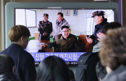 People watch a TV news program showing an image, published in North Korea's Rodong Sinmun newspaper, of North Korean leader Kim Jong Un at the country's Sohae launch site, at Seoul Railway station in Seoul, South Korea, Sunday, March 19, 2017. North Korea has conducted a ground test of a new type of high-thrust rocket engine that leader Kim Jong Un is calling a revolutionary breakthrough for the country's space program. (AP Photo/Ahn Young-joon)