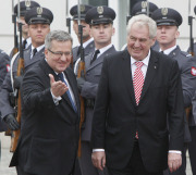 Czech Republic President Milos Zeman, right, and his Polish counterpart Bronislaw Komorowski walk in front of the guard of honor during the welcoming ceremony in Warsaw, Poland, Thursday, May 23, 2013.Zeman came to Poland for an official two day visit. (AP Photo/Czarek Sokolowski)