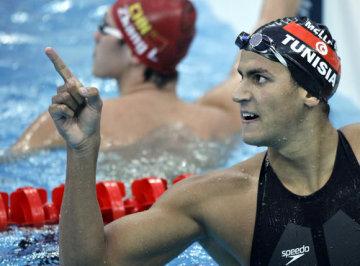 Tuniský plavec Usáma Mellúlí získal zlatou olympijskou medaili v závodě na 1500 metrů volný způsob