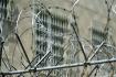 Věznice, vězení, ostnatý drát, plot - ilustrační foto.