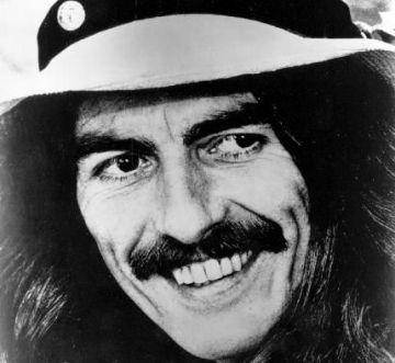 Ilustrační foto - Člen Beatles George Harrison na snímku z roku 1974.