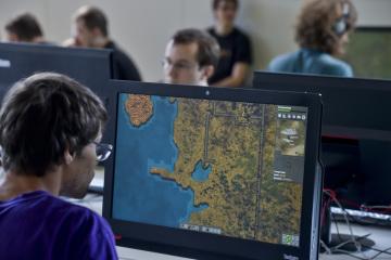 V pražské Národní technické knihovně se 23. července 2018 uskutečnilo setkání s vývojáři české strategické počítačové hry Factorio.