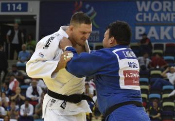 Mistrovství světa v judu - muži nad 100 kg, 26. září 2018 v Baku. Český judista Lukáš Krpálek (v bílém) ve vítězném souboji s Tuvšinbajarem Naidanem z Mongolska.
