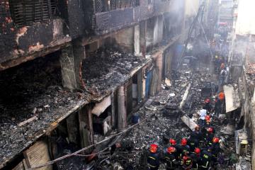 Následky požáru jednoho z domů v bangladéšské metropoli Dháce.